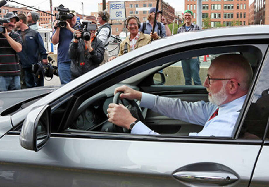 Carney, lawyer for Whitey Bulger, tries to negotiate a turn into a parking lot outside of  Moakley Federal Court this morning, June 12, 2013.  Photo: Mark Garfinkel/Boston Herald / Mark Garfinkel/Boston Herald