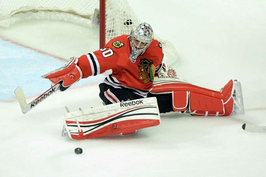 CHICAGO, IL - JUNE 12:  Corey Crawford #50 of the Chicago Blackhawks makes a save against the Boston Bruins in Game One of the 2013 NHL Stanley Cup Final at United Center on June 12, 2013 in Chicago, Illinois. Photo: Harry How, Getty Images / 2013 Getty Images