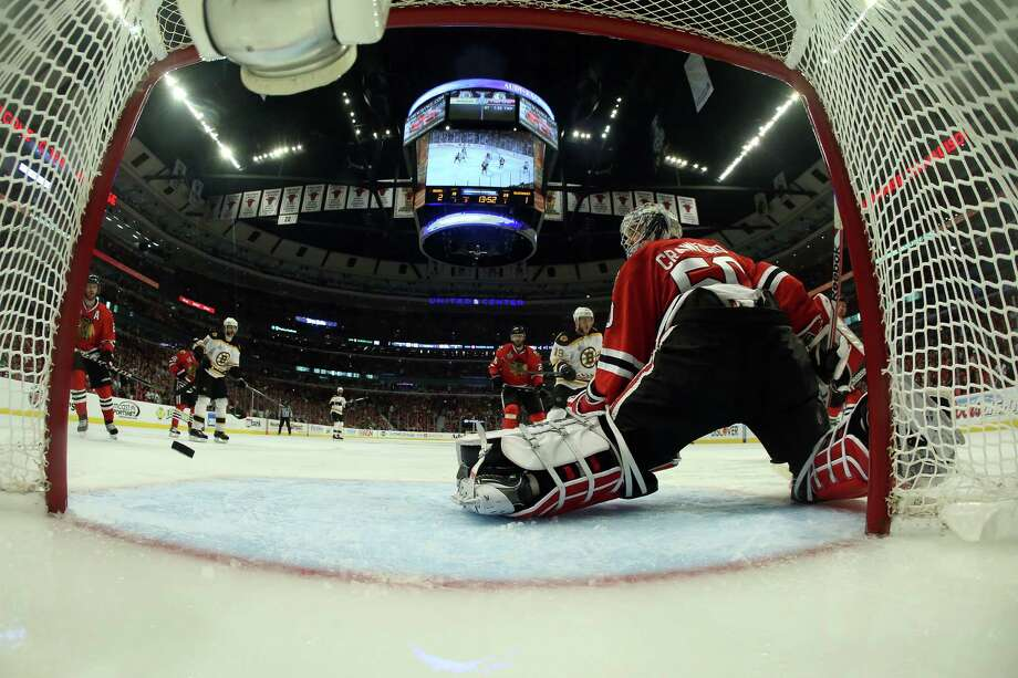 CHICAGO, IL - JUNE 12:  Patrice Bergeron #37 of the Chicago Blackhawks (not pictured) scores a goal in the third period against goalie Corey Crawford #50 of the Chicago Blackhawks in Game One of the 2013 NHL Stanley Cup Final at United Center on June 12, 2013 in Chicago, Illinois. Photo: Bruce Bennett, Getty Images / 2013 Getty Images