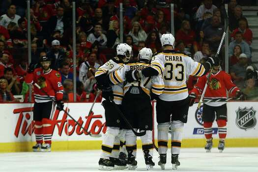 CHICAGO, IL - JUNE 12:  (L-R) Jaromir Jagr #68, Patrice Bergeron #37 and Zdeno Chara #33 of the Boston Bruins celebrate after Bergeron scored a goal in the third period against the Chicago Blackhawks in Game One of the NHL 2013 Stanley Cup Final at United Center on June 12, 2013 in Chicago, Illinois. Photo: Bruce Bennett, Getty Images / 2013 Getty Images