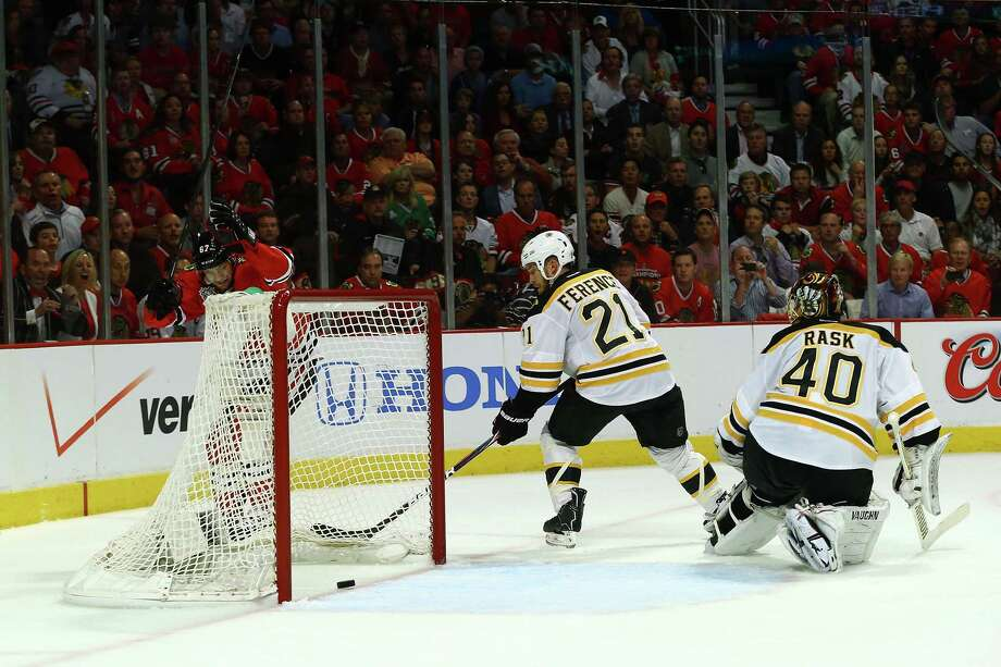 CHICAGO, IL - JUNE 12:  Michael Frolik #67 of the Chicago Blackhawks celebrates after Johnny Oduya (not pictured) #27 scored a goal in the third period against goalie Tuukka Rask #40 of the Boston Bruins in Game One of the NHL 2013 Stanley Cup Final at United Center on June 12, 2013 in Chicago, Illinois. Photo: Bruce Bennett, Getty Images / 2013 Getty Images