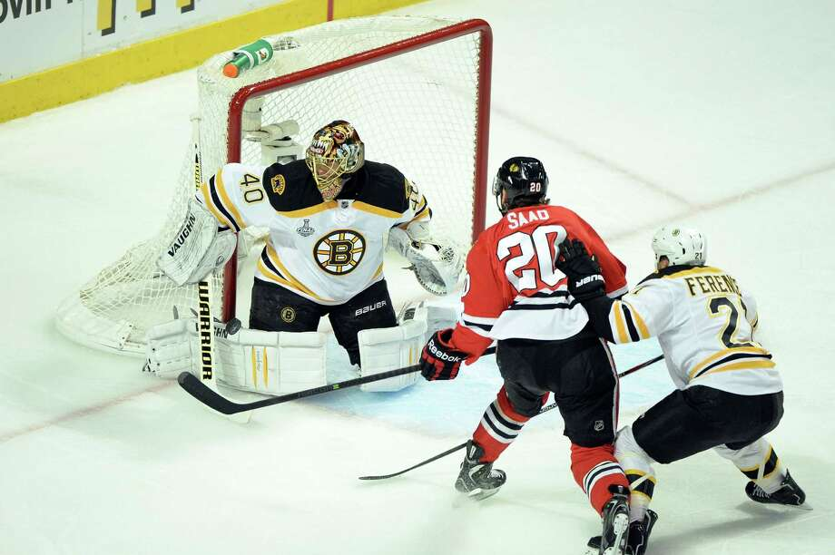CHICAGO, IL - JUNE 12:  Tuukka Rask #40 of the Boston Bruins tends goal against Brandon Saad #20 of the Chicago Blackhawks in Game One of the 2013 NHL Stanley Cup Final at United Center on June 12, 2013 in Chicago, Illinois. Photo: Harry How, Getty Images / 2013 Getty Images