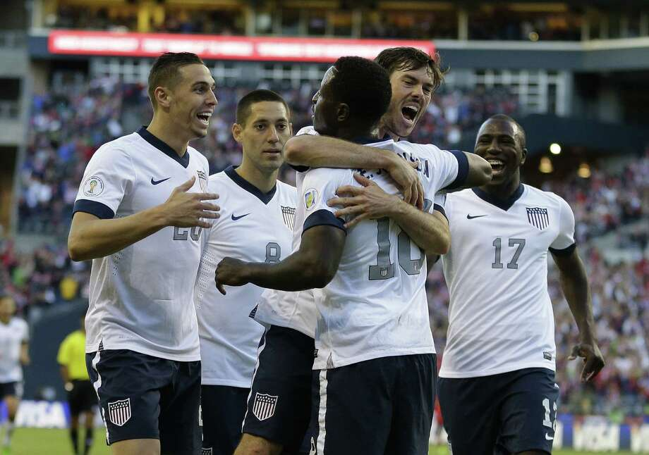 Brad Evans (upper right) hugs Eddie Johnson after Johnson scored in the United States' 2-0 win over Panama in a World Cup qualifier late Tuesday. Photo: Ted S. Warren / Associated Press