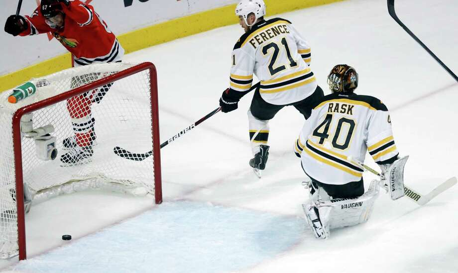 Boston Bruins goalie Tuukka Rask (40) and Boston Bruins defenseman Andrew Ference (21) watch as the puck slides into the goal shot by Chicago Blackhawks defenseman Johnny Oduya during the third period of Game 1 in their NHL Stanley Cup Final hockey series, Wednesday, June 12, 2013 in Chicago. (AP Photo/Charles Rex Arbogast) Photo: Charles Rex Arbogast, Associated Press / AP