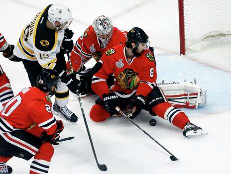 Chicago Blackhawks defenseman Nick Leddy (8) and Chicago Blackhawks goalie Corey Crawford (50) make a save on a shot by Boston Bruins center Tyler Seguin (19) during the first period of Game 1 in their NHL Stanley Cup Final hockey series on Wednesday, June 12, 2013, in Chicago. (AP Photo/Charles Rex Arbogast) Photo: Charles Rex Arbogast, Associated Press / AP