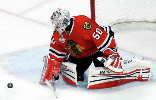 Chicago Blackhawks goalie Corey Crawford (50) blocks a shot during the third period of Game 1 in their NHL Stanley Cup Final hockey series against the Boston Bruins,Wednesday, June 12, 2013 in Chicago. (AP Photo/Charles Rex Arbogast) Photo: Charles Rex Arbogast, Associated Press / AP