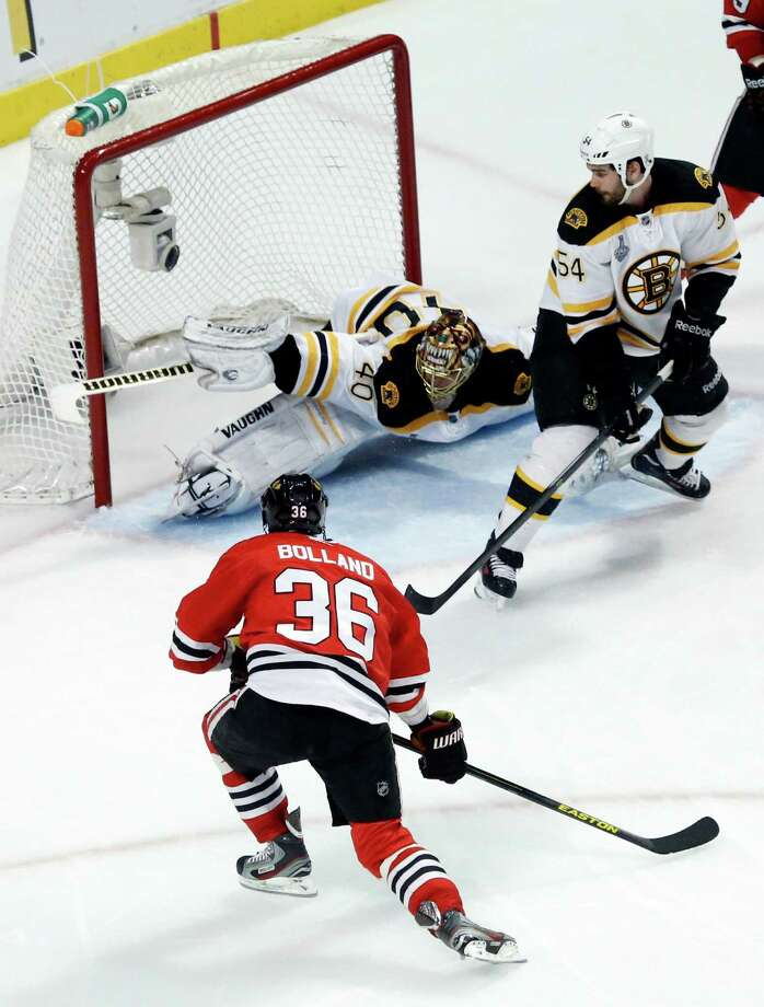 Chicago Blackhawks center Dave Bolland (36) scores a goal against Boston Bruins goalie Tuukka Rask (40) during the third period of Game 1 in their NHL Stanley Cup Final hockey series on Wednesday, June 12, 2013, in Chicago. (AP Photo/Charles Rex Arbogast) Photo: Charles Rex Arbogast, Associated Press / AP