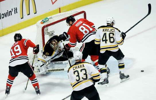 Boston Bruins goalie Tuukka Rask (40) makes a save on a shot by Chicago Blackhawks right wing Marian Hossa (81) during the first period of Game 1 in their NHL Stanley Cup Final hockey series on Wednesday, June 12, 2013, in Chicago. (AP Photo/Charles Rex Arbogast) Photo: Charles Rex Arbogast, Associated Press / AP
