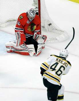 Chicago Blackhawks goalie Corey Crawford (50) makes a save on a shot by Boston Bruins center David Krejci (46) during the first period of Game 1 in their NHL Stanley Cup Final hockey series,Wednesday, June 12, 2013 in Chicago. (AP Photo/Charles Rex Arbogast) Photo: Charles Rex Arbogast, Associated Press / AP
