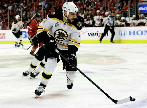 Boston Bruins left wing Milan Lucic (17) controls the puck against Chicago Blackhawks during the first period of Game 1 in their NHL Stanley Cup Final hockey series, Wednesday, June 12, 2013, in Chicago. (AP Photo/Nam Y. Huh) Photo: Nam Y. Huh, Associated Press / AP