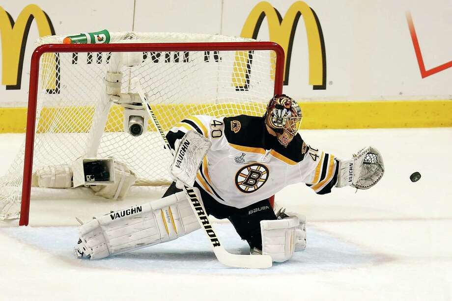 CHICAGO, IL - JUNE 12:  Goalie Tuukka Rask #40 of the Boston Bruins makes a save in the first period against the Chicago Blackhawks in Game One of the 2013 NHL Stanley Cup Final at United Center on June 12, 2013 in Chicago, Illinois. Photo: Gregory Shamus, Getty Images / 2013 Getty Images