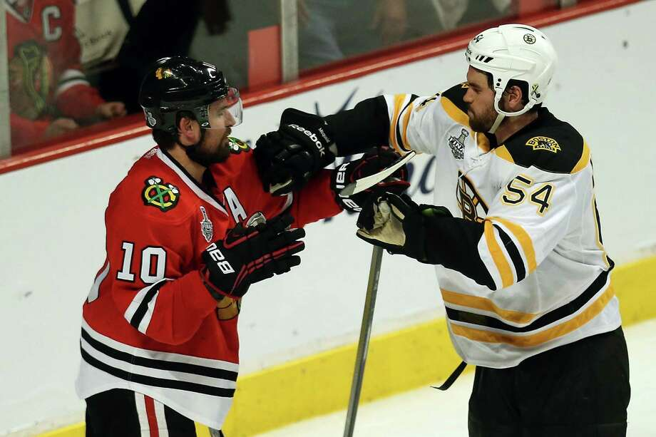 CHICAGO, IL - JUNE 12:  Patrick Sharp #10 of the Chicago Blackhawks shoves Adam McQuaid #54 of the Boston Bruins in the second period in Game One of the 2013 NHL Stanley Cup Final at United Center on June 12, 2013 in Chicago, Illinois. Photo: Jonathan Daniel, Getty Images / 2013 Getty Images