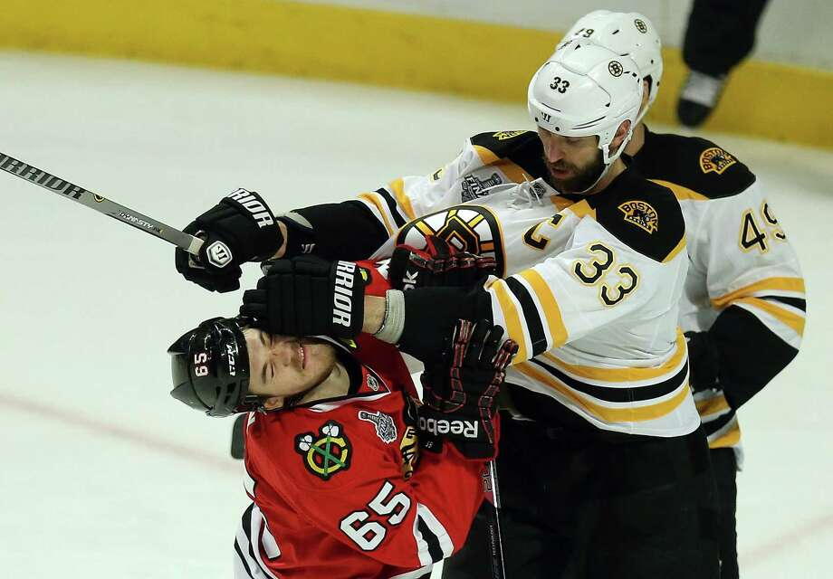 CHICAGO, IL - JUNE 12:  Zdeno Chara #33 of the Boston Bruins pushes Andrew Shaw #65 of the Chicago Blackhawks in the second period in Game One of the 2013 NHL Stanley Cup Final at United Center on June 12, 2013 in Chicago, Illinois. Photo: Jonathan Daniel, Getty Images / 2013 Getty Images