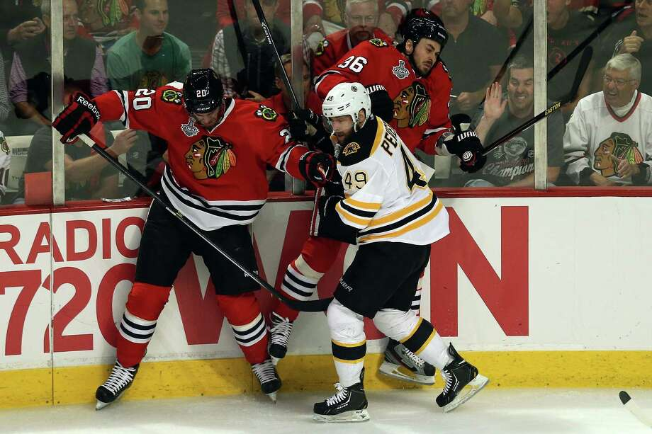 CHICAGO, IL - JUNE 12:  Brandon Saad #20 and Dave Bolland #36 of the Chicago Blackhawks fight for position against Rich Peverley #49 of the Boston Bruins in Game One of the 2013 NHL Stanley Cup Final at United Center on June 12, 2013 in Chicago, Illinois. Photo: Jonathan Daniel, Getty Images / 2013 Getty Images
