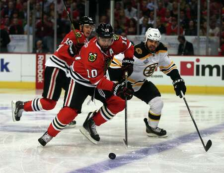 The Chicago Blackhawks' Patrick Sharp (10) carries the puck against the Boston Bruins' Nathan Horton, right, in the first period of Game 1 of the NHL Finals on Wednesday, June 12, 2013, at the United Center in Chicago, Illinois. (Brian Cassella/Chicago Tribune/MCT) Photo: Brian Cassella, McClatchy-Tribune News Service / Chicago Tribune