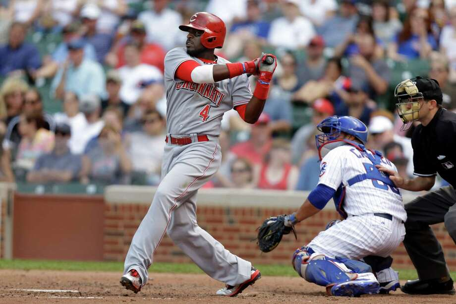 CHICAGO, WI - JUNE 12: Brandon Phillips #4 of the Cincinnati Reds singles scoring teammate Shin-Soo Choo #17 in the top of the sixth inning against the Chicago Cubs at Wrigley Field on June 12, 2013 in Chicago, Illinois. (Photo by Mike McGinnis/Getty Images) Photo: Mike McGinnis