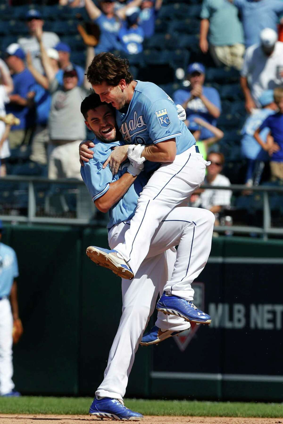 The Royals' Eric Hosmer, left, and Mike Moustakas get carried away after Hosmer's single beat the Tigers.