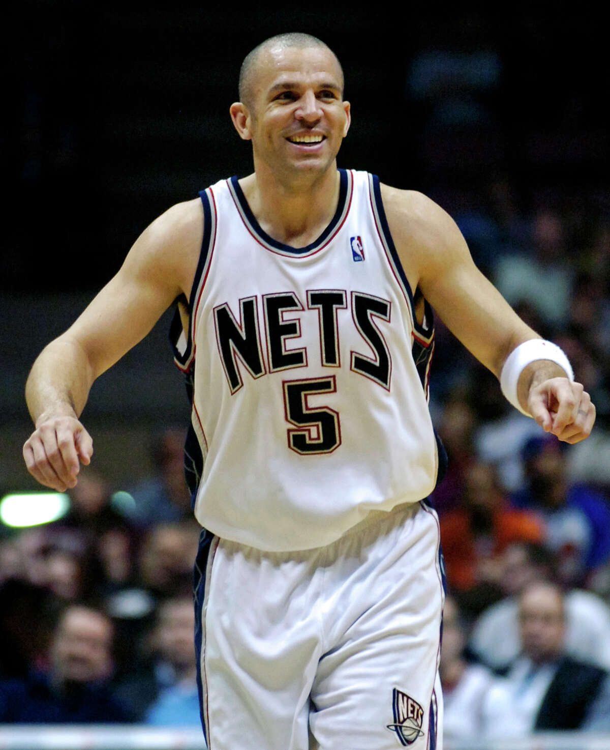 FILE - In this April 13, 2007, file photo, then-New Jersey Nets' Jason Kidd reacts during an NBA basketball game in East Rutherford, N.J. The Brooklyn Nets hired Jason Kidd as their coach Wednesday, June 12, 2013, bringing the former star back to the franchise he led to its greatest NBA success. (AP Photo/Bill Kostroun, File)