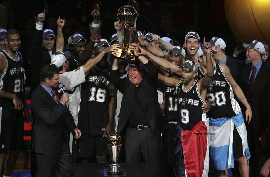 Peter Holt and the Spurs accept the Larry O'Brien Trophy after Game Four of the NBA Finals Thursday, June 14, 2007 at Quicken Loans Arena. BAHRAM MARK SOBHANI/STAFF
