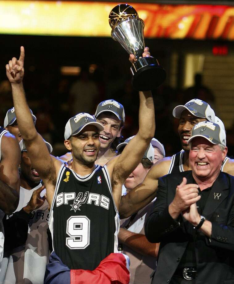 FOR SPORTS - Spurs' guard Tony Parker, of France, (09) holds the MVP trophy, as he celebrates with CEO and Chairman Peter Holt and members of the team after sweeping the Cavaliers in game 4 in the NBA Finals at the Quicken Loans Arena Thursday June 14, 2007, in Cleveland, OH. (EDWARD A. ORNELAS/STAFF)