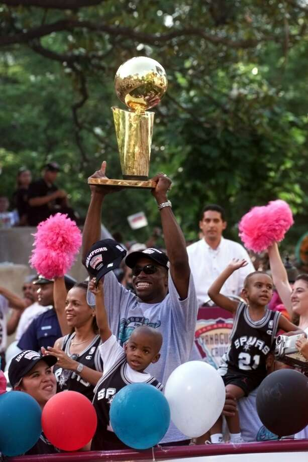 Avery Johnson shows the Larry Johnson trophy at the Arneson theater on the Riverwalk Sunday June 27, 1999.