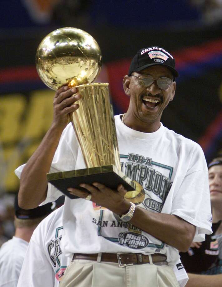 George Gervin, the Iceman, holds the Larry Brown trophy Sunday June 27, 1999 at the Alamodome.