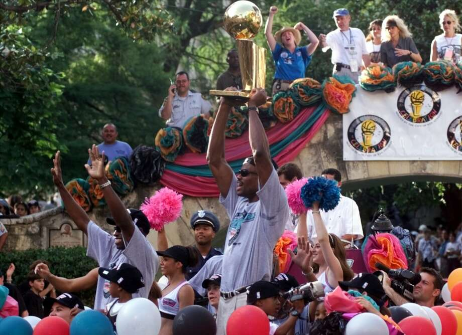 David Robinson and Avery Johnson show the Larry Johnson trophy at the Arneson theater on the Riverwalk Sunday June 27, 1999.