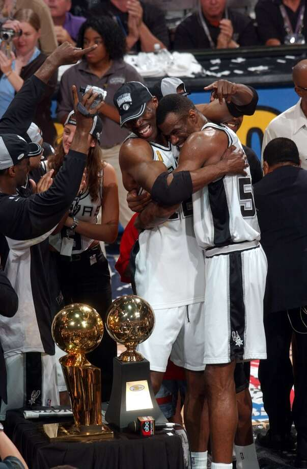 The Spurs' Kevin Willis and David Robinson hug during the trophy presentation after winning the NBA Championship at the SBC Center on  June 15, 2003.