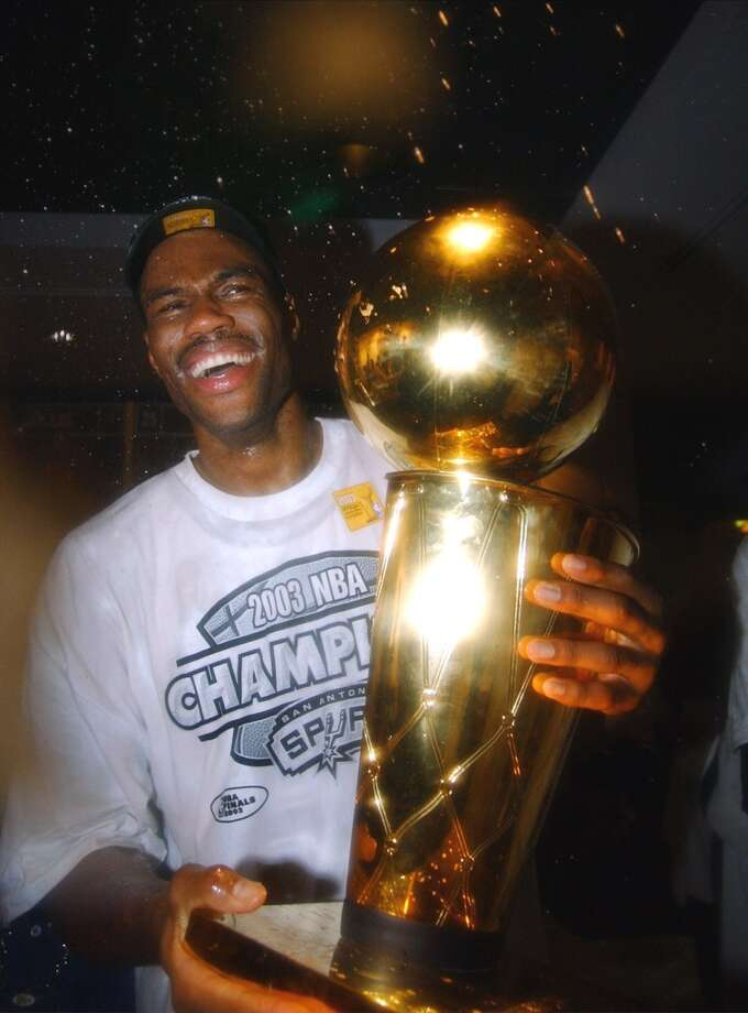David Robinson with Larry O'Brien NBA Championship trophy celebrates in the locker room Game 6 of the NBA Finals on  June 15, 2003 at the SBC Center.