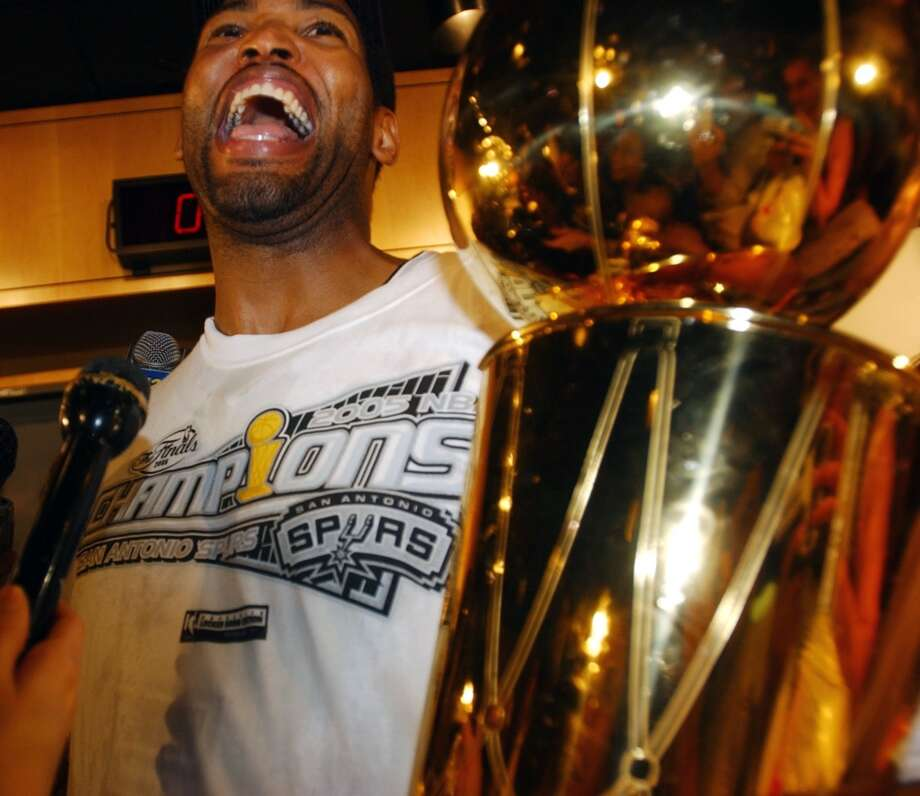 Robert Horry holds the Larry O'Brien Trophy in the locker room following Game 7 of the NBA Finals at the SBC Center on June 23, 2005.