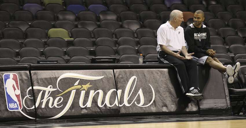 Coach Gregg Popovich (left) and Tony Parker chat during practice and media sessions at the AT&T Center on Wednesday, June 12, 2013.