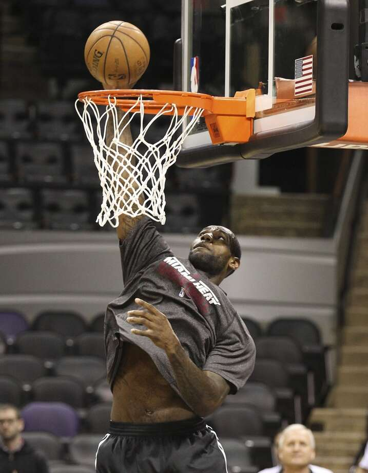 LeBron James goes up for a dunk during practice and media sessions at the AT&T Center on Wednesday, June 12, 2013.