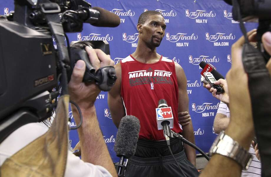 Miami's Chris Bosh gets interviewed during practice and media sessions at the AT&T Center on Wednesday, June 12, 2013.