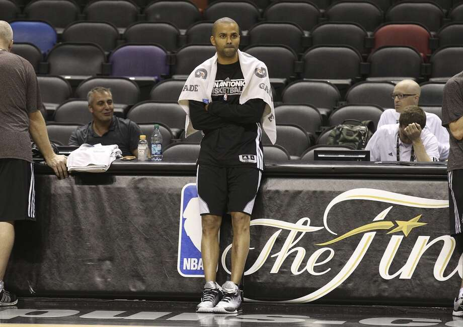Tony Parker stands along the sideline during practice and media sessions at the AT&T Center on Wednesday, June 12, 2013.