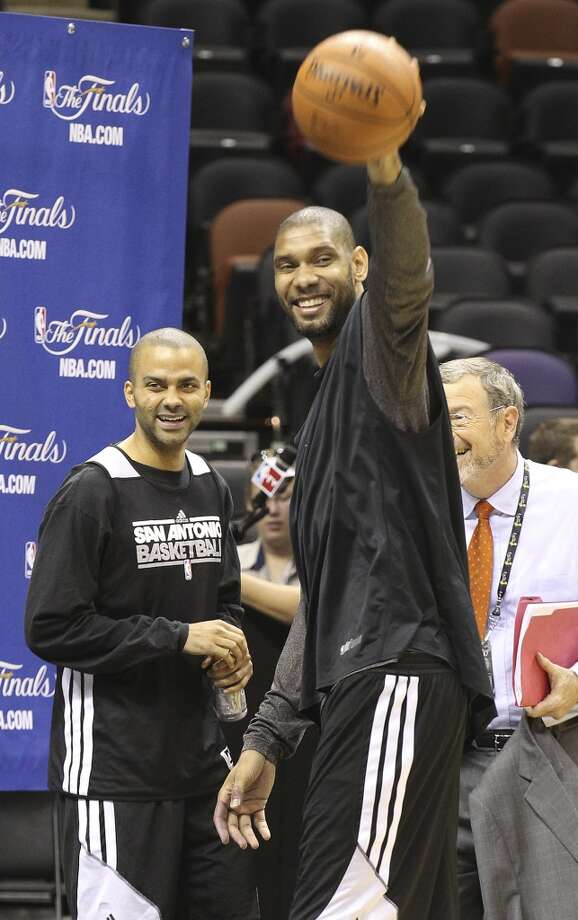 Tony Parker (left) and Tim Duncan share a laugh during practice and media sessions at the AT&T Center on Wednesday, June 12, 2013.