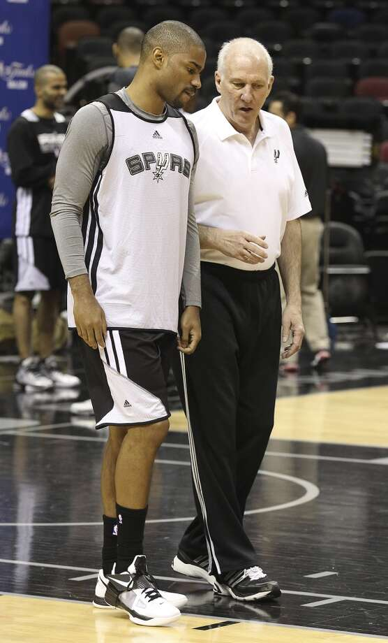 Gary Neal (left) and coach Gregg Popovich chat during practice and media sessions at the AT&T Center on Wednesday, June 12, 2013.