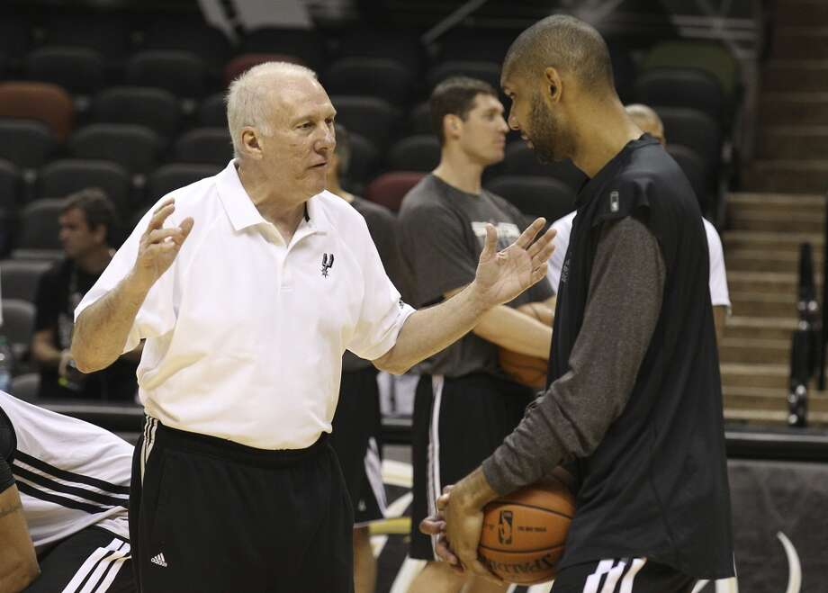 Gregg Popovich (left) and Tim Duncan chat during practice and media sessions at the AT&T Center on Wednesday, June 12, 2013.
