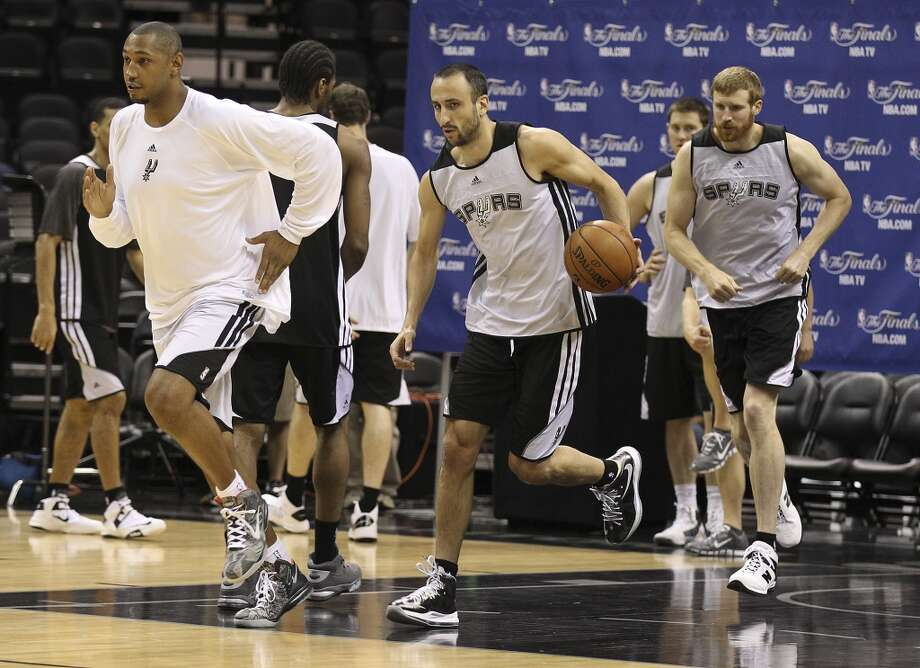 Boris Diaw (from left), Manu Ginobili and Matt Bonner workout during practice and media sessions at the AT&T Center on Wednesday, June 12, 2013.