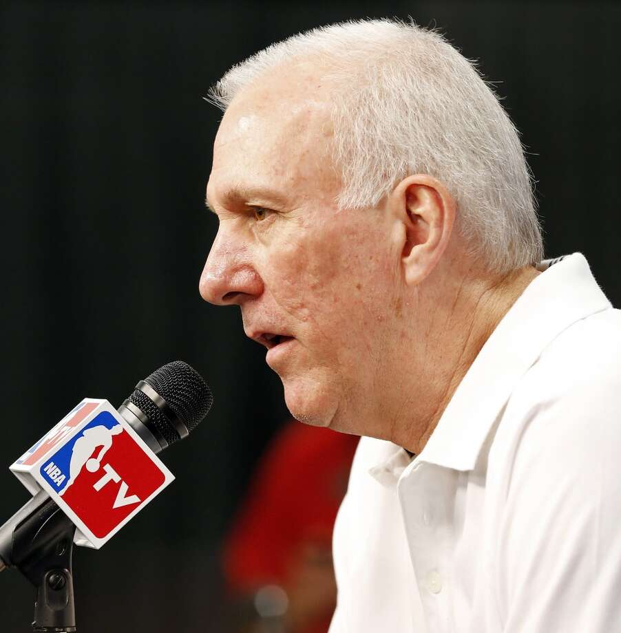 San Antonio Spurs head coach Gregg Popovich answers questions from the media during practice Wednesday June 12, 2013 at the AT&T Center.