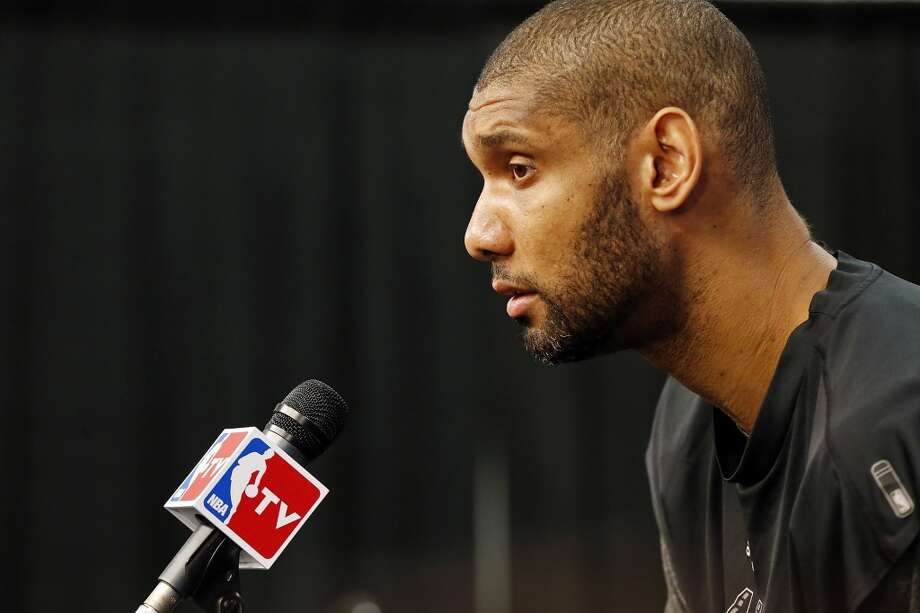 San Antonio Spurs' Tim Duncan answers questions from the media during practice Wednesday June 12, 2013 at the AT&T Center.