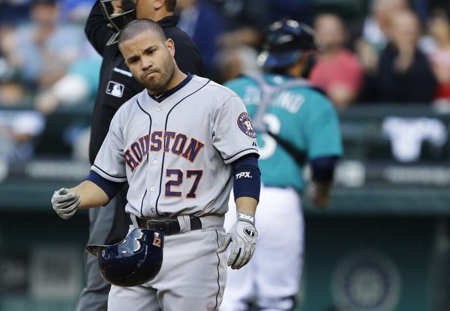 Jose Altuve tosses his helmet after being called out on strikes in the third inning.