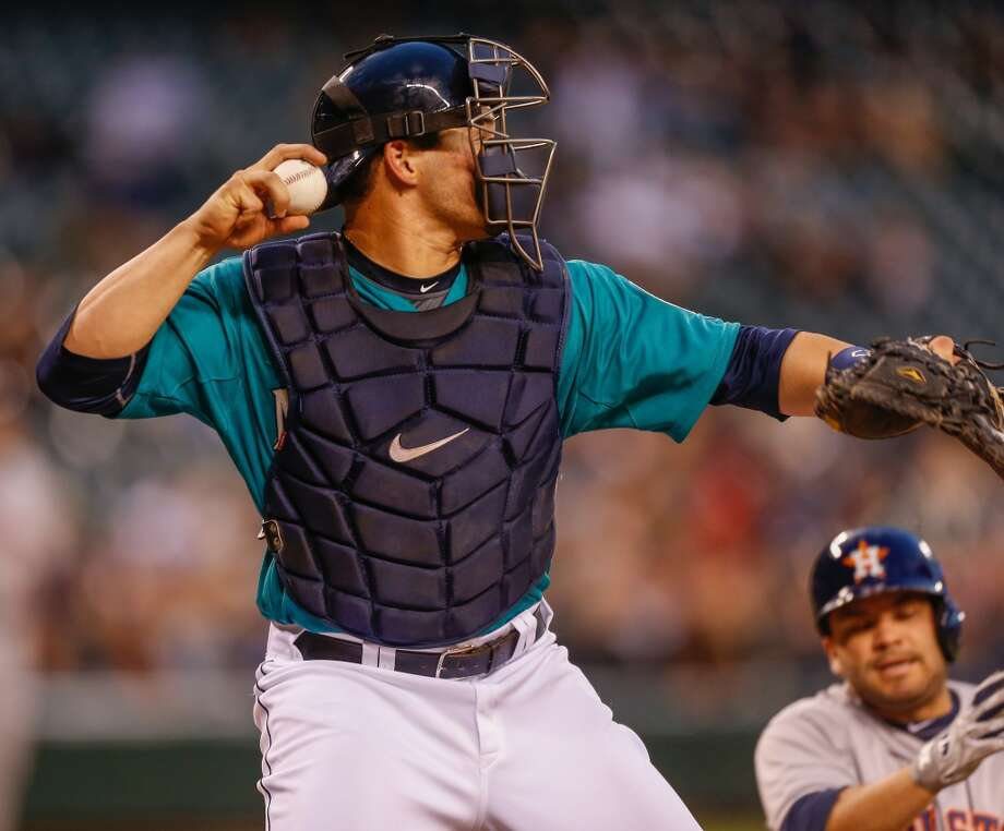 Mike Zunino of the Mariners throws out Marwin Gonzalez on a steal attempt.