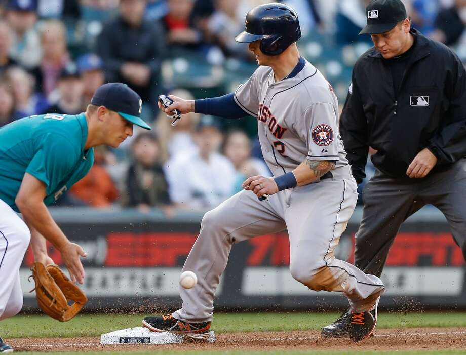 Brandon Barnes of the Astros advances to third on a fly ball out by Marwin Gonzalez.
