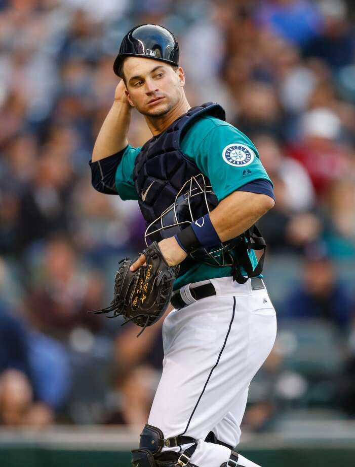 Mike Zunino of the Mariners heads back to the dugout at the end of the third inning. Photo: Otto Greule Jr, Getty Images