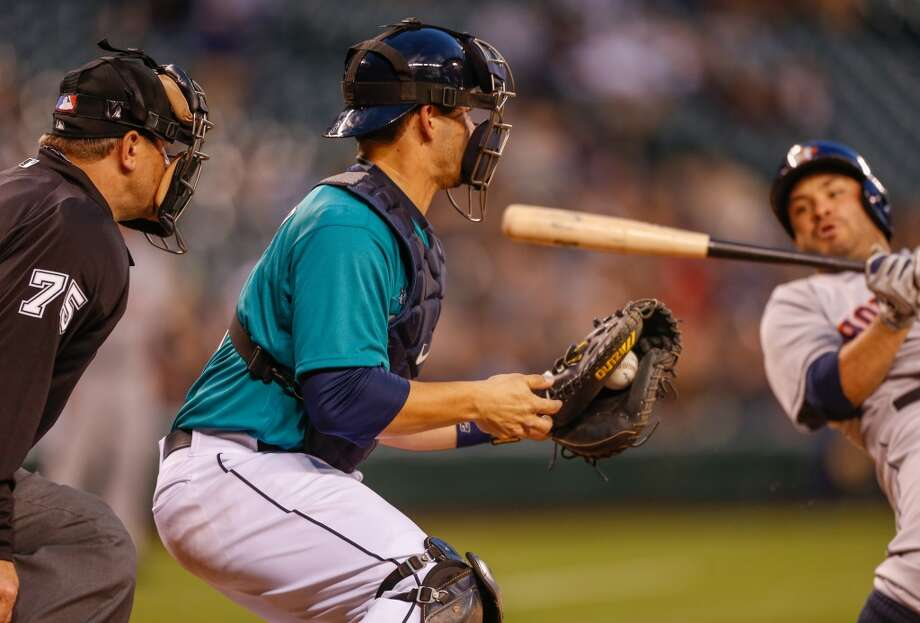 Mike Zunino of the Mariners readies to throw out Marwin Gonzalez of the Astros on a steal attempt.