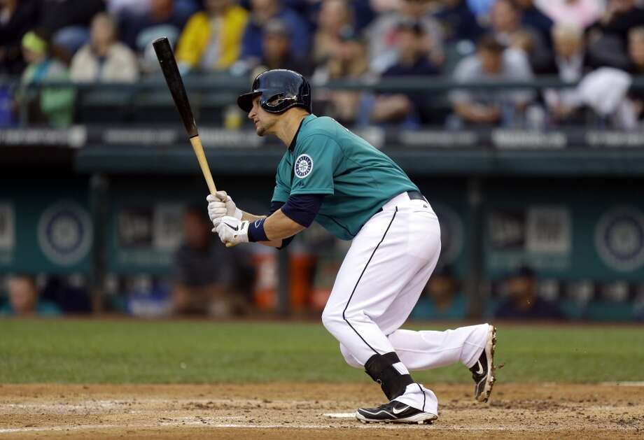 Mike Zunino heads to first base after getting his first major league hit. Photo: Ted S. Warren, Associated Press