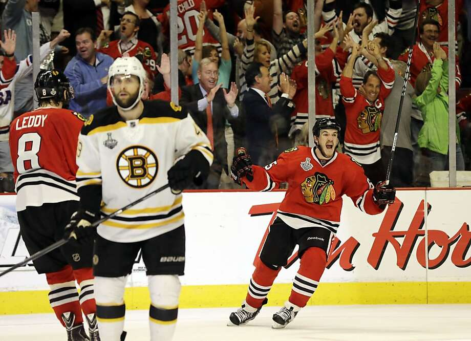 Chicago Blackhawks center Andrew Shaw, right, celebrates after scoring the winning goal during the third overtime period of Game 1 in their NHL Stanley Cup Final hockey series against the Boston Bruins, Thursday, June 13, 2013, in Chicago. (AP Photo/Nam Y. Huh) Photo: Nam Y. Huh, Associated Press