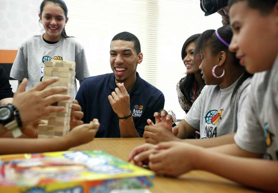 Spurs player Danny Green plays Jenga during the NBA Cares event Wednesday at Wheatley Middle School in the San Antonio ISD, where a Learn and Play Center was unveiled.