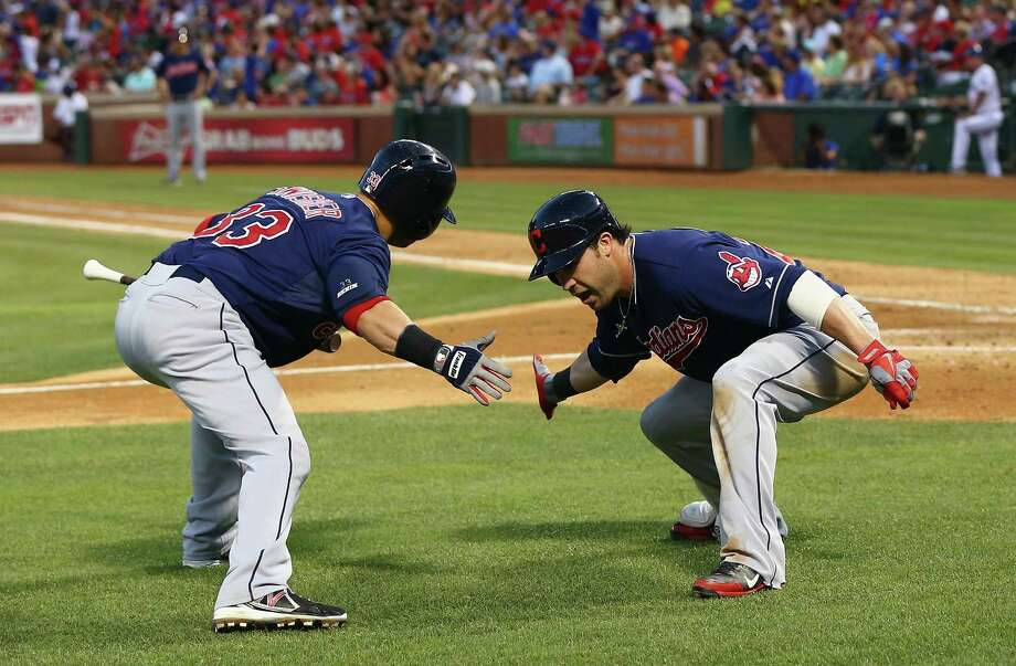 Nick Swisher (left) congratulates Jason Kipnis on his homer for the Indians in the fifth inning Wednesday.