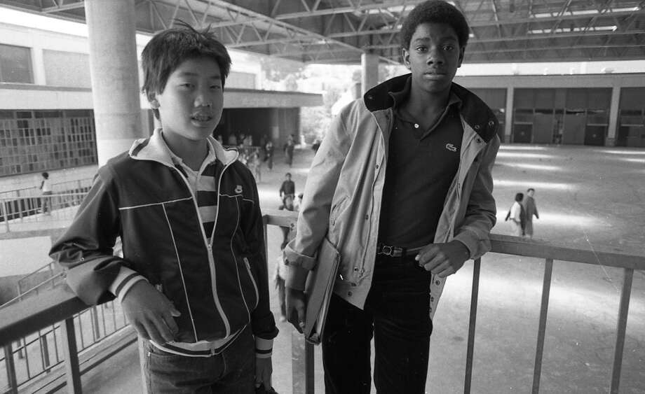 Kid on the left is looking fly in a Nike tracksuit, but still has the nervous forced smile that reminds me of my own freshman year of high school. Note the vinyl belt with interlocking clasp on the right. That and a braided leather belt were pretty much all you could buy in 1982. Photo: Gary Fong, The Chronicle